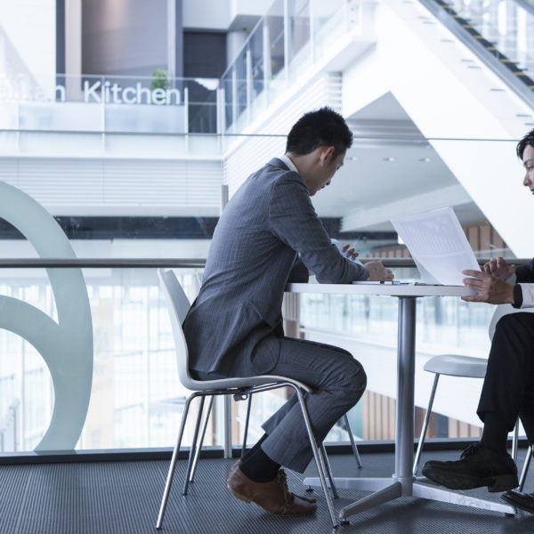 Businessmen have a meeting in the lobby